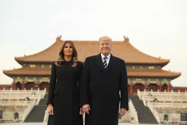 US President Donald Trump and first lady Melania Trump pose during a tour of the forbidden city, on Wednesday. Photo: AP