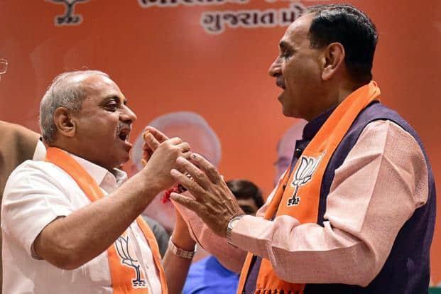 Gujarat CM Vijay Rupani (right) and his deputy Nitin Patel at BJP party office in Gandhinagar on Friday. Photo: PTI