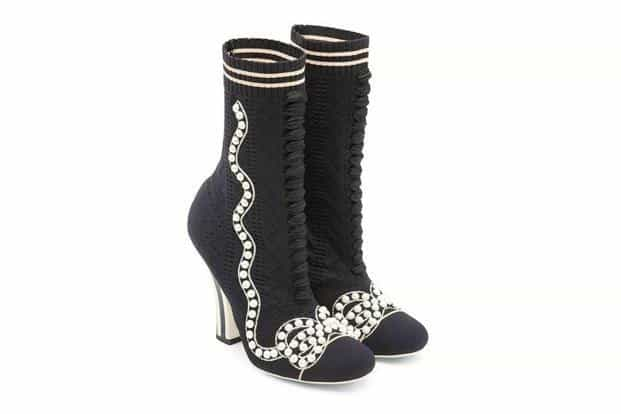 The sock boot is a natural progression from the thigh-high satin boots popularized by Karl Lagerfeld for Chanel in 1990.