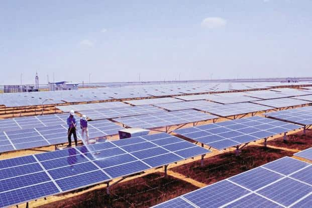 The expansion plans comes against the backdrop of record low green energy tariffs that will impact project developers' margins. Photo: PTI