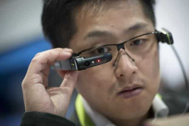 An attendee wears the Vuzix Corp. M300 augmented reality (AR) smart glasses during the 2018 Consumer Electronics Show (CES) in Las Vegas on Wednesday. Photo: Bloomberg