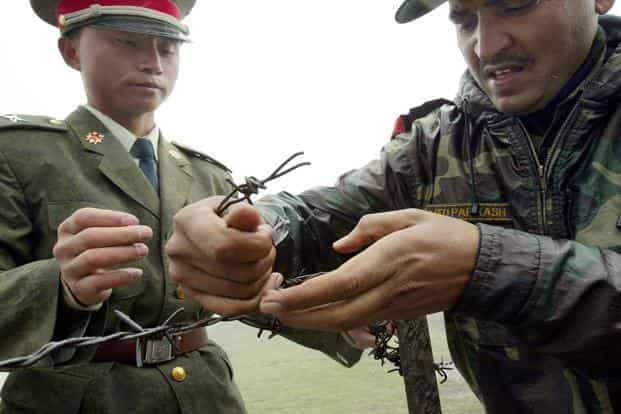 Indian and Chinese troops were locked in a standoff for over two months last year in the Doklam area near Sikkim before 'disengaging' on 28 August. Photo: AFP