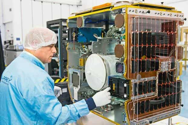 The RemoveDEBRIS spacecraft during final assembly at the Surrey Space Centre. Photo: SSTL/Max Alexander