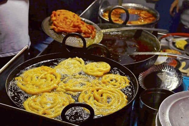 Crisp, hot 'jalebis' and 'jalebas' are sold in Sarafa Bazaar from 8pm-2am. Photo: PTI