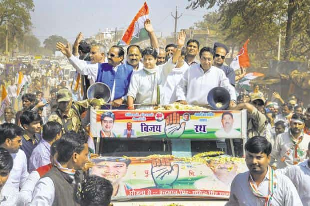 Congress leader Jyotiraditya Scindia, centre, with Kamal Nath, right,  and others during a road show ahead of Kolaras bypoll, in Madhya Pradesh on Thursday. Photo: PTI