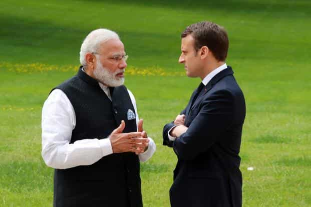 A file photo of Prime Minister Narendra Modi with French President Emmanuel Macron in Paris. Photo: AFP