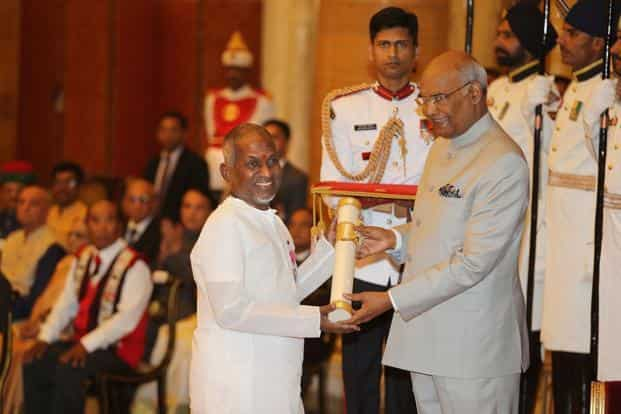 Indian President Ram Nath Kovind (right) confers the Padma Vibhushan award to Ilaiyaraaja, a noted music composer and the president of Vivekananda Kendra, during an event at the presidential palace in New Delhi. Photo: PTI