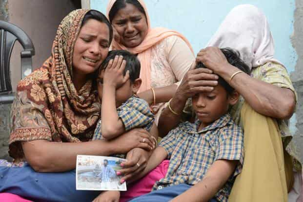 Resident Seema (left), with her sons Karan and Arjun, after external affairs minister Sushma Swaraj confirmed that her husband Sonu had been killed in Iraq, at Chawinda Devi village near Amritsar on Tuesday. Photo: AFP