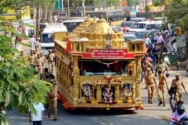 Police personnel look on as they walk along side the chariot modelled on the proposed Ram Janma Bhoomi Temple travelling as a part of Ram Rajya Rath Yatra, organised by VHP, from Ayodhya to Rameswaram as it reached Madurai on Wednesday. Photo: PTI