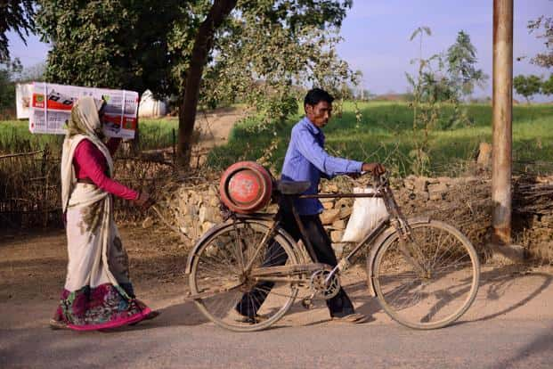 The Pradhan Mantri Ujjwala Yojana aims to safeguard the health of women and children by providing them with LPG cylinders, so that they are protected from smoke while cooking. Photo: Pradeep Gaur/Mint
