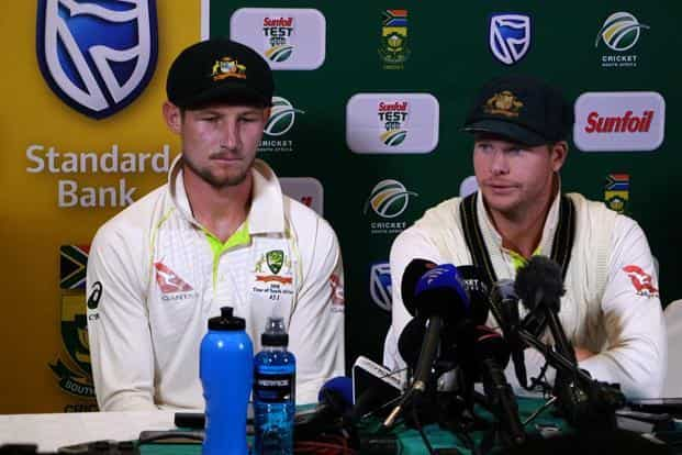 Australia's captain Steve Smith, right, with teammate Cameron Bancroft, during a press conference in Cape Town, on Saturday as he admitted to ball-tampering during the third Test against South Africa. Photo: AFP