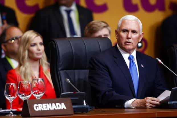 US vice president Mike Pence (R) speaks at the plenary session at the Americas Summit, as Ivanka Trump, daughter of US President Donald Trump sits behind him, in Lima, Peru, Saturday, 14 April, 2018. Photo: AP