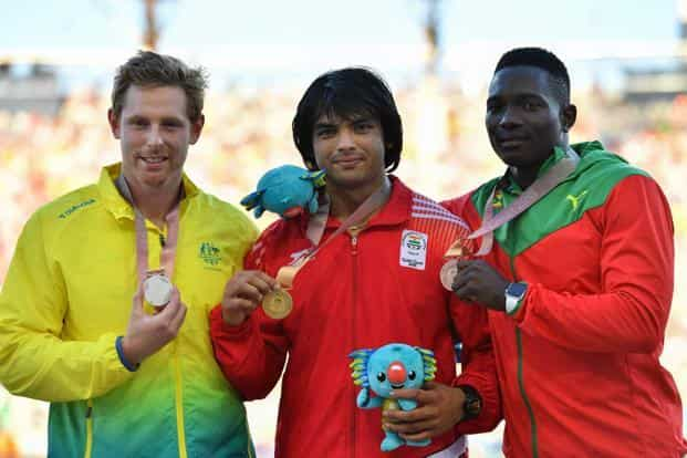 Neeraj Chopra (C Gold), Hamish Peacock (L Silver), Anderson Peters (Bronze) pose with their medals after men's javelin throw final in  2018  Commonwealth Games at Gold Coast on 14 April 2018. Photo: AFP