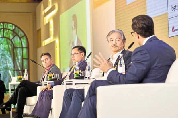 From left) Brad Loiselle, founder, president and CEO of education technology start-up BetterU; Arthur Lang, CEO of International at SingTel, and Robert Yap, executive chairman of logistics firm YCH Group.