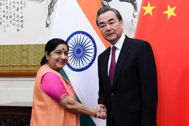 India's foreign minister Sushma Swaraj (L) shakes hands with China's foreign minister Wang Yi at the Diaoyutai State Guest House in Beijing on Sunday. Photo: AFP