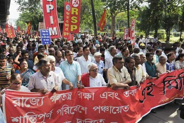 Left Front chairman Biman Bose and CPI(M) state secretary Surya Kanta Mishra with other left leaders participate in a protest rally against political violence allegedly sponsored by the state government, in Kolkata on Monday. Photo: PTI