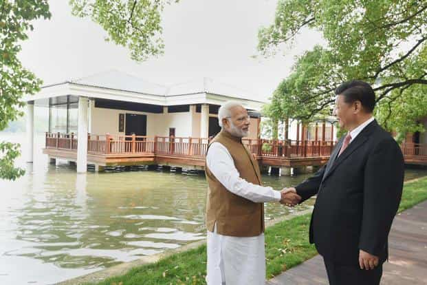 Prime Minister Narendra Modi with Chinese President Xi Jinping along the East Lake, in Wuhan, China on Saturday. Photo: PTI