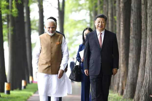 Prime Minister Narendra Modi and Chinese President Xi Jinping walk together in Wuhan, China. Photo: AP