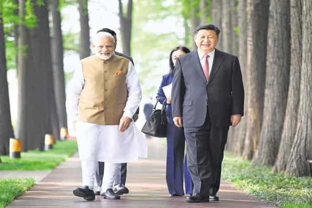 In this photo released by China's 'Xinhua News Agency', PM Modi, and Chinese President Jinping walk together in Wuhan in central China's Hubei Province on Saturday. Photo: AP
