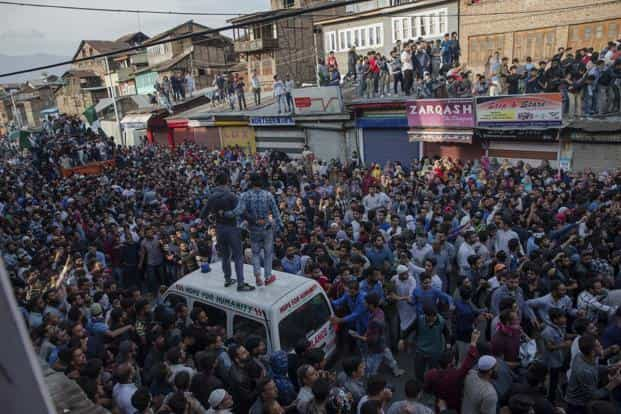 Kashmiri Muslims take part in the funeral procession of a militant in Srinagar on Saturday. Photo: AP