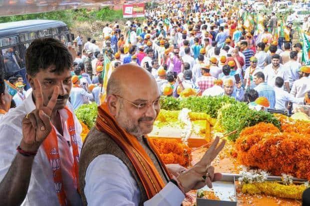 Amit Shah during a road show ahead of Karnataka assembly elections at Ullal in Mangaluru. Photo: PTI