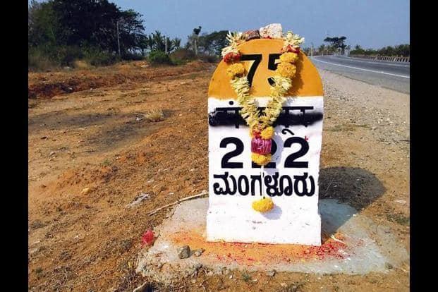 The Devanagari script painted over on this milestone, en route to Mangaluru. Photo: Twitter@purviraju1