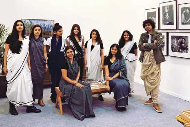 Staff of GallerySke and PhotoInk, dressed in saris by Sanjay Garg. Photo courtesy: Galleryske