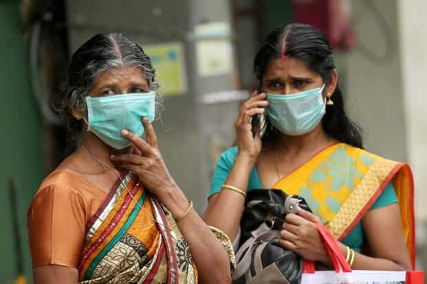 Family members of the patients admitted at the Kozhikode Medical College wear safety masks as a precautionary measure after the 'Nipah' virus outbreak, in Kozhikode, on Tuesday. Photo: PTI