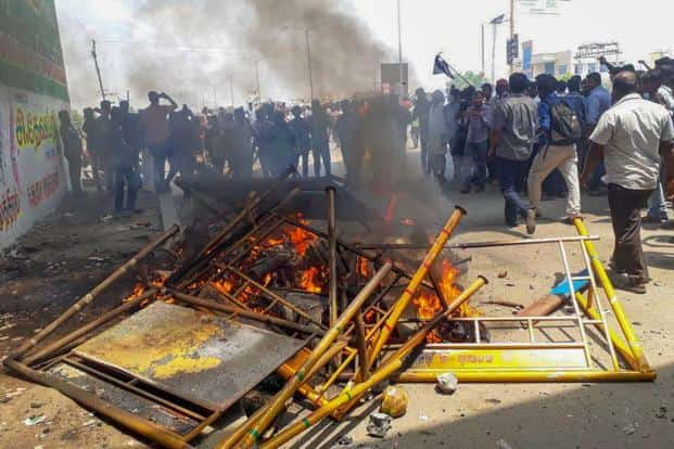 Smoke billows from burning barricades as agitators march through streets demanding the closure of Vedanta's Sterlite Copper unit in Tuticorin on Tuesday. The agitation turned violent with police opening fire in which 11 people were killed. Photo: PTI