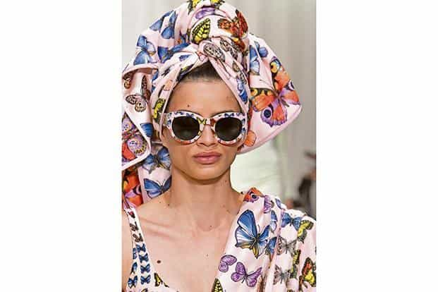 bd93ecc145 ... Models in Versace and Prada sunglasses. Photo  Getty Images