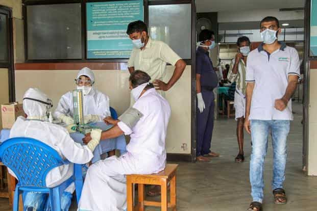 Doctors and patients wear safety masks as a precautionary measure after the Nipah virus outbreak at a Medical college in Kozhikode. Photo: PTI