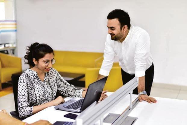 Joy Sharma, co-founder of Impactify, with his first intern, Divya Ahuja. Photo: Pradeep Gaur/Mint