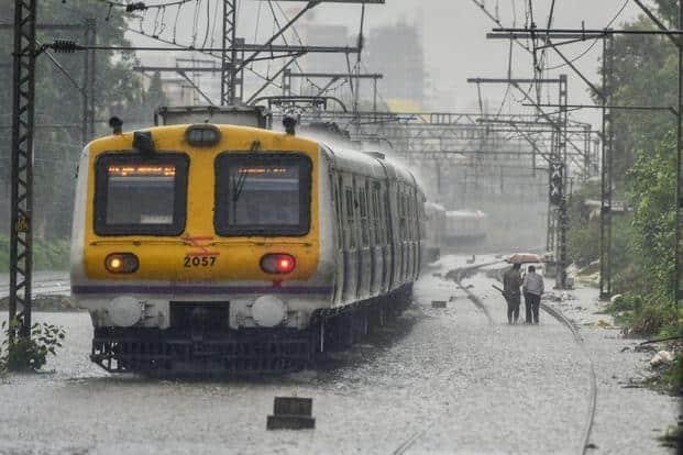 A local train chugs at waterlogged tracks following heavy monsoon showers in Mumbai on Saturday. IMD deputy director K. S. Hosalikar says, 'Heavy to very heavy rainfall was recorded in the suburbs till 8.30 am' in Mumbai. Photo: PTI