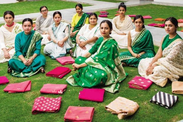 Members of Raw Mango's Delhi office and flagship store wearing the label's signature handloom sarees. Photo: Ashish Shah/Mint