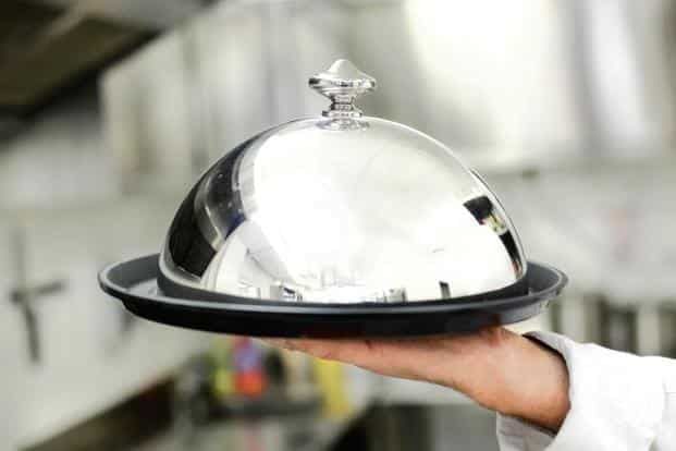 Ask room service to bring your food covered with a cloche and not in a hot box. Photo: iStock