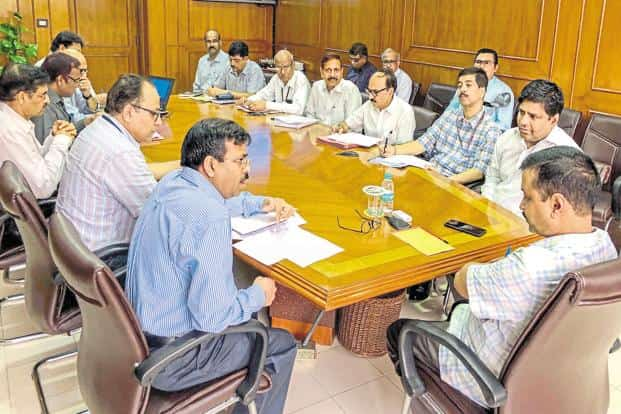 Delhi chief minister Arvind Kejriwal reviews progress of ongoing projects with Delhi Jal Board officials on Thursday. Photo: PTI