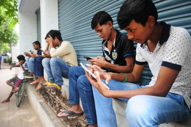 According to the Ficci-EY media and entertainment industry report 2017, smartphone penetration reached around 33% of the country in the year. Photo: Mint