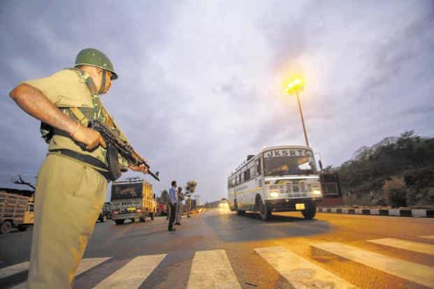 A paramilitary personnel keeps vigil on the outskirts of Jammu on Thursday. Photo: PTI