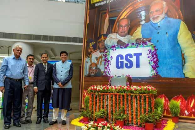 Finance minister Piyush Goyal poses for a photo during the 'GST Day celebration' on completing one year in New Delhi on Sunday. Photo: PTI