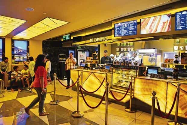 Multiplexes will either battle for a reduction in investment costs, such as mall rentals and realty prices, or raise ticket rates to counteract the loss in F&B sales. Photo: Pradeep Gaur/Mint