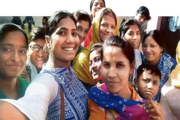 Manisha Mashaal from the NGO Swabhimaan Society takes a selfie with anti-caste activists in Kurukshetra.