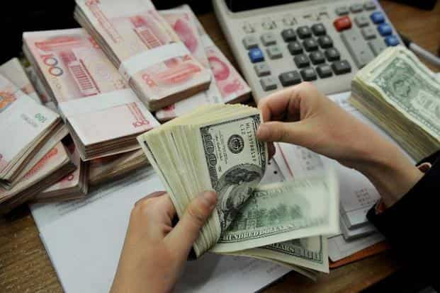 Though forex cards are convenient to use, understand the charges, advantages and disadvantages before using. Photo: AFP