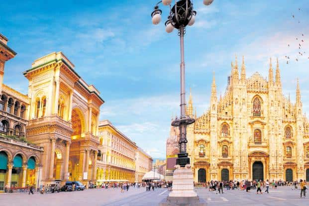 The Piazza Del Duomo, with the cathedral and the galleria's arched entrance to the left. Photo: iStock