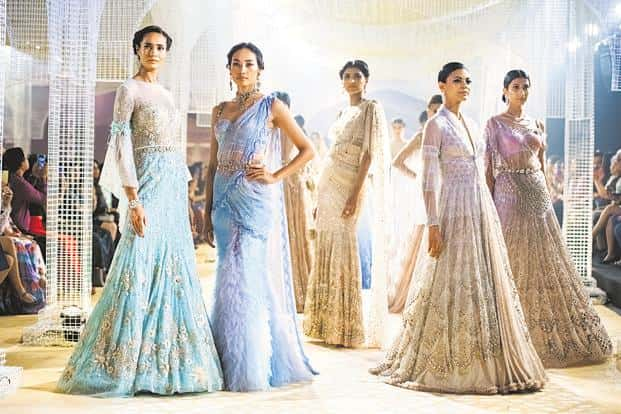 Tarun Tahiliani experimented with draping techniques on gossamer fabrics offset with bejewelled accents.