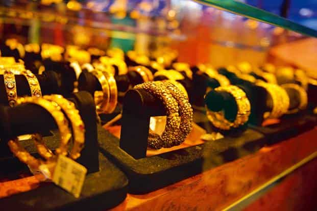 Globally, gold rose 0.51% to $1,213.30 an ounce and silver gained 0.62% to$15.38 an ounce in New York in yesterday's trade. Photo: Mint