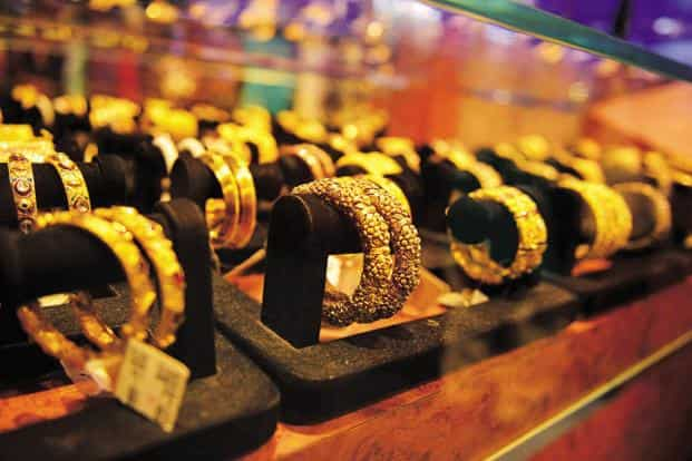Globally, gold fell 0.07% to ₹1,211.20 an ounce and silver by 0.94% to ₹15.28 an ounce in New York in yesterday's trade. Photo: Mint