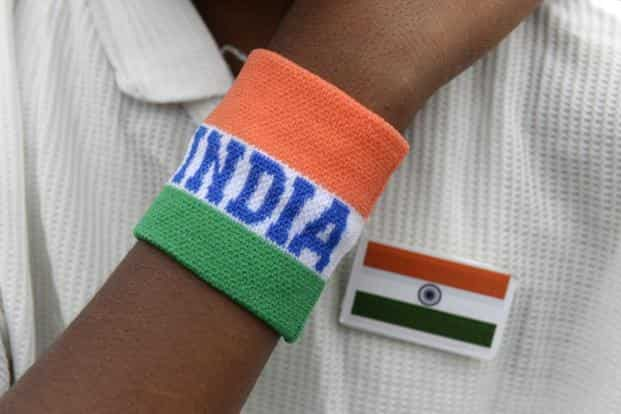 An Indian student wearing his national flag and themed wristband participates in Independence Day celebrations in Secunderabad. Photo: AFP