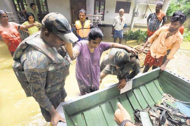 Army personnel rescue people from inundated areas in Kerala's Alappuzha district on Sunday. Photo: Raj K. Raj/HT