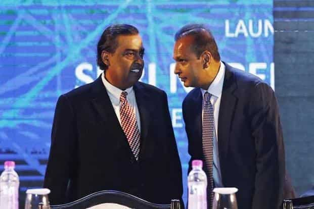Anil Ambani and Mukesh Ambani. The RCom-Jio deal entails sale of wireless spectrum, tower, fibre and MCN assets, the proceeds of which were to be used by Reliance Communications to reduce debt. Photo: Reuters