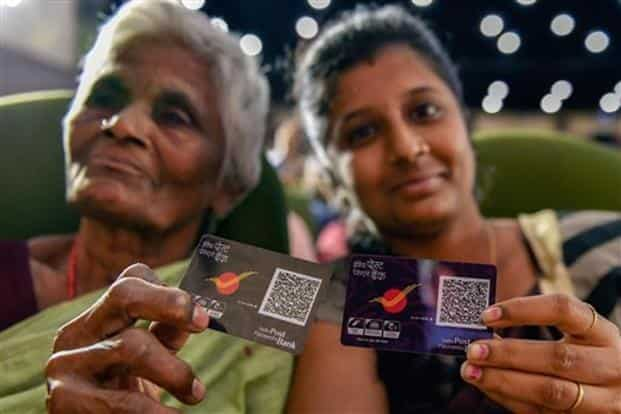 Beneficiaries display their digital QR code at the launch of India Post Payments Bank (IPPB), in Chennai on Saturday. Photo: PTI